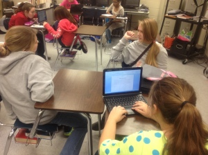 Calyn, Hannah, and Amanda use technology in the classroom to prepare an article about what the students are doing to improve the image of their school, including cleanups and beautification projects.